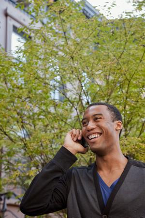 Smiling Black man talking on cell phone