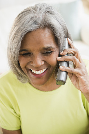 African American woman talking on telephone Stock Photo