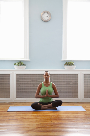 Black woman practicing yoga Stock Photo