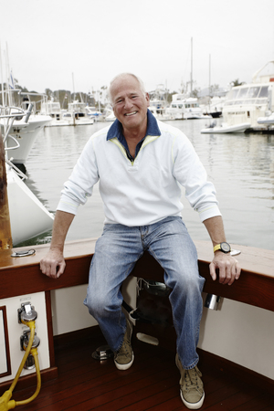 Smiling man sitting on boat