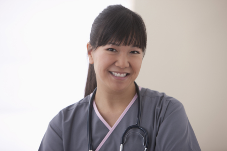 Smiling Asian surgeon