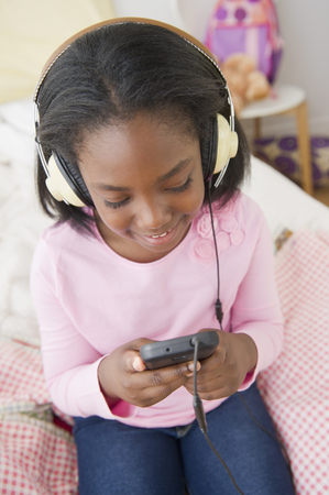 Black girl listening to mp3 player