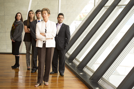 Hispanic business people standing together Stock Photo