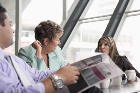 Hispanic business people on break together