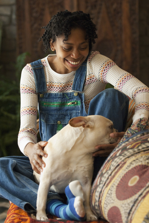 Black woman petting her dog