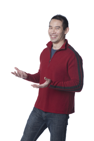 Smiling Chinese man with arms outstretched Фото со стока