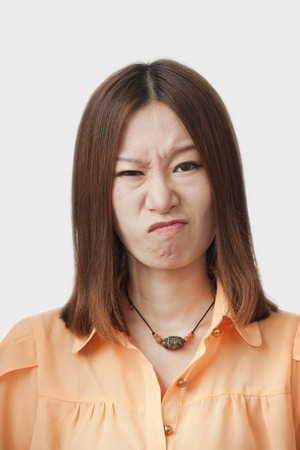 Frowning Chinese woman