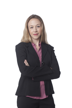 Smiling Caucasian businesswoman with arms crossed Stock Photo