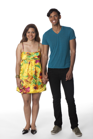 Smiling Hispanic couple standing together