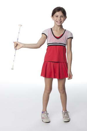 Caucasian girl twirling a baton Stock Photo - 107972196