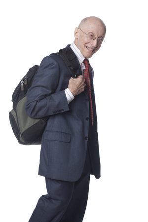 Senior Caucasian businessman carrying backpack