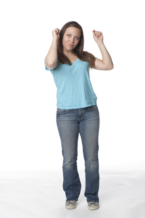 Smiling Caucasian woman with arms raised Stock Photo - 107972233