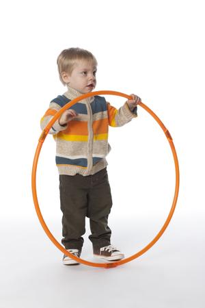 Caucasian boy holding plastic hoop