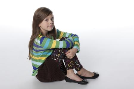 Caucasian girl hugging knees Stock Photo - 107972239