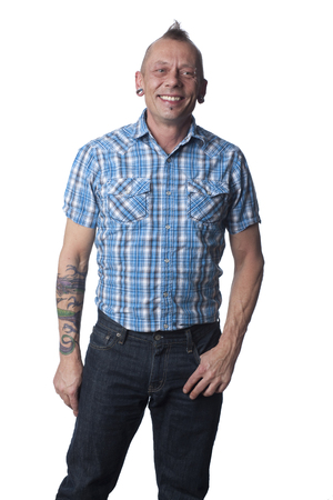 Tattooed Caucasian man with hand in pocket