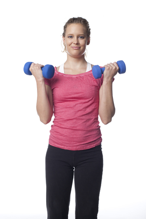 Caucasian woman lifting hand weights Stock Photo
