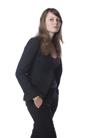 Serious businesswoman with hands in pockets Stock Photo