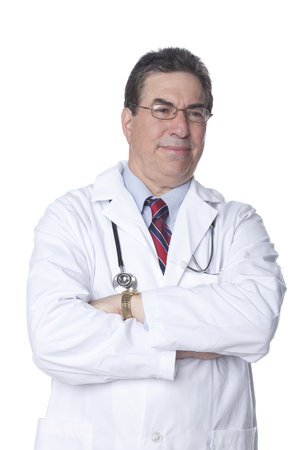 Serious doctor with arms crossed Stock Photo