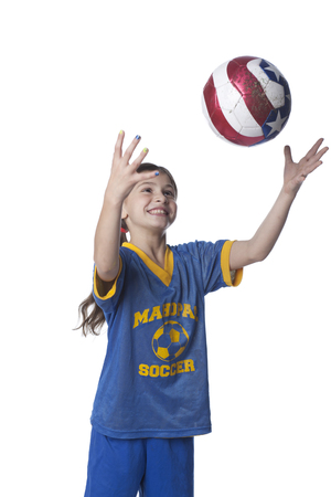 Caucasian girl playing with soccer ball