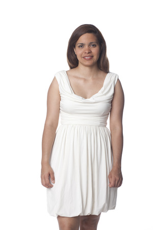 Smiling Hispanic woman in dress Stock Photo