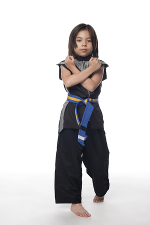 Mixed race girl in ninja outfit Stok Fotoğraf