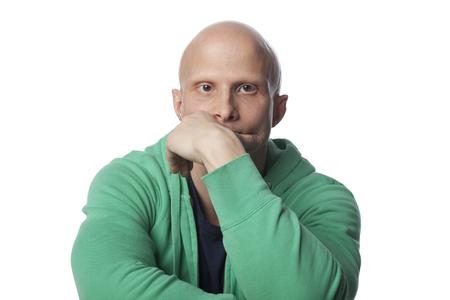 Serious, bald Caucasian man
