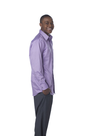 Smiling Black man with hands in pockets