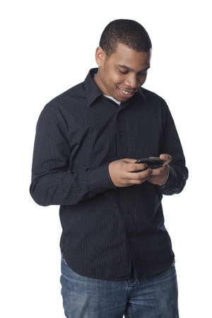 Smiling man text messaging on cell phone