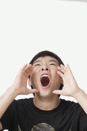 Shouting Chinese man Stock Photo
