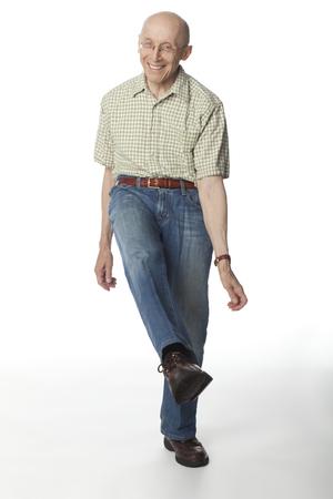 Smiling Caucasian man dancing Stock Photo