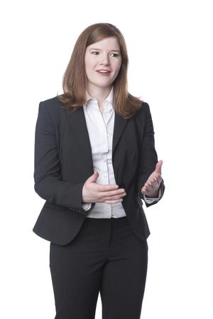 Smiling Caucasian businesswoman gesturing