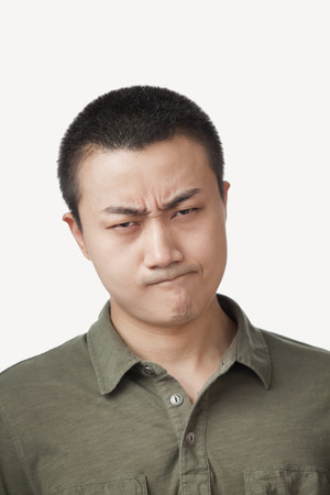 Frowning Chinese man