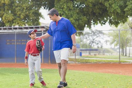 Hispanic coach and young baseball player