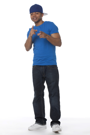 Mixed race man in baseball cap pointing