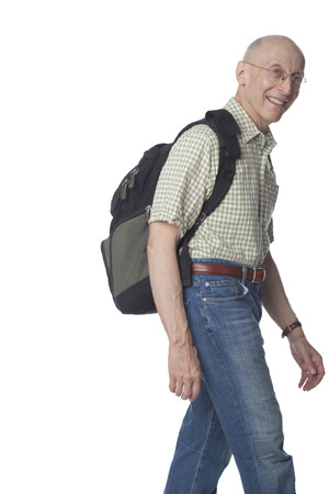 Smiling senior Caucasian man carrying backpack