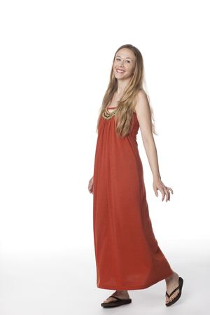 Smiling Caucasian woman in long dress Stock Photo