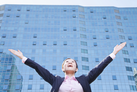 Chinese businesswoman with arms outstretched Stock Photo