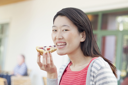 Chinese woman eating pie Stock Photo