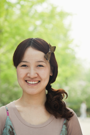Smiling Chinese woman Stock Photo