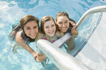 Caucasian teenagers relaxing in swimming pool
