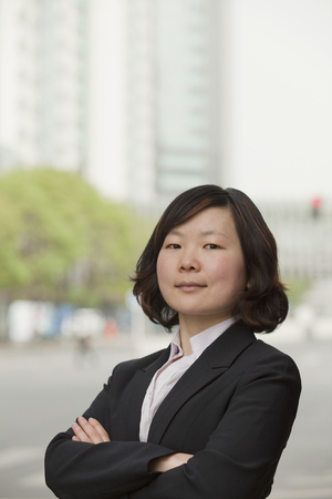 Chinese businesswoman with arms crossed
