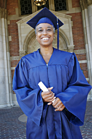 Smiling Black woman holding graduation diploma Stock Photo - 107972295