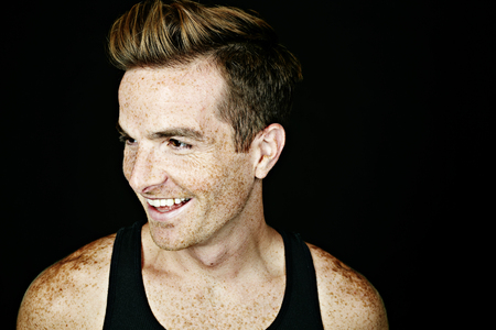 Smiling Caucasian man with freckles