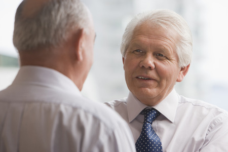 Chilean businessman talking to co-worker