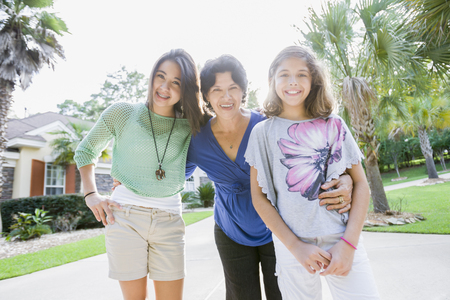 Smiling Hispanic grandmother and granddaughters
