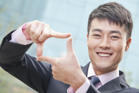 Chinese businessman making frame gesture