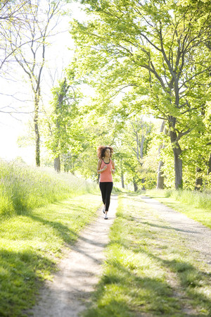 Hispanic woman running in park