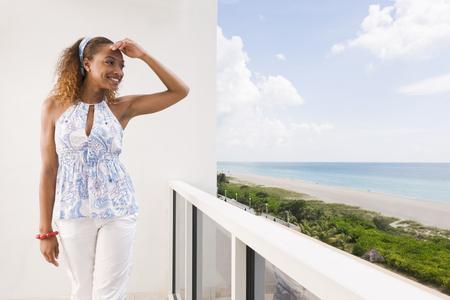 Mixed race woman overlooking beach