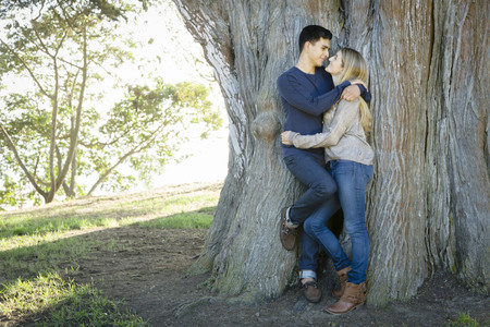 Smiling couple hugging in park Stock Photo