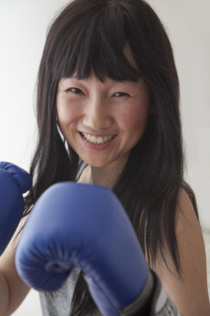 Chinese boxer with raised fists Stock Photo